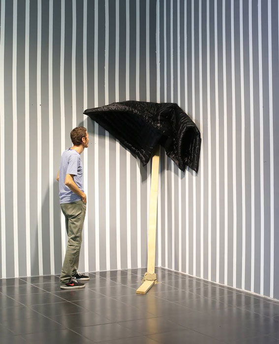 """Black Duvet, 2015, silk, batting, wood and clay, 130x180x12cm, 47.2x70.8,4.7 in ( instalation view,R.E.M.X /Rapid Eye Movement""""No matter how fast you are, there's always someone faster""""MAFA/Media Art Festival Arad, 2015 )"""